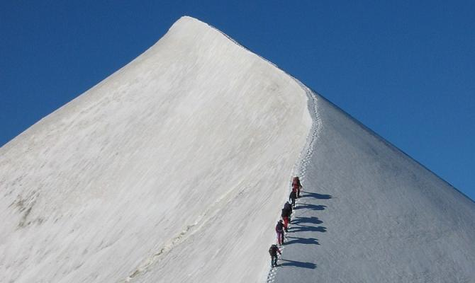Ascending the arête to the summit of the Domes du Miages