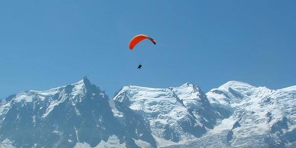 A tandem paraglider flight in front of the Mont Blanc massif. Photo: Charmian Heaton