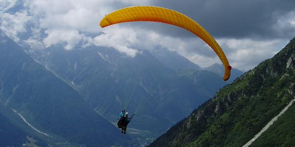 Paraglider flight from the Aiguilles Rouges, Mont Blanc massif. Photo: Robin Popham