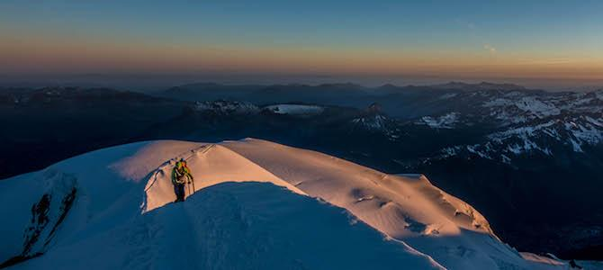 Sunrise on the Bosses Arete of the Gouter route on Mont Blanc